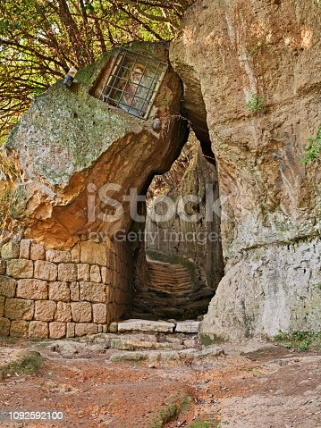 Pitigliano, Grosseto, Tuscany, Italy: the Via Cava of Saint Joseph, one of the long Etruscan trench dug into the tuff rock that linked ancient necropolis and several settlements in the area of Sovana, Sorano and Pitigliano