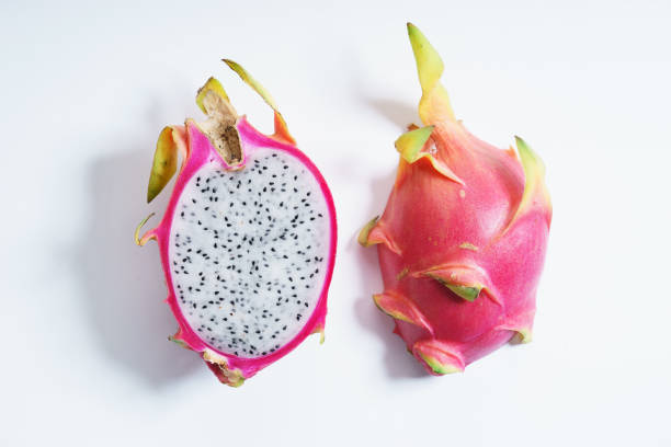 pitiya, dragon fruit fresh dragon fruit, cut in a half, on white background. top view. pitaya stock pictures, royalty-free photos & images