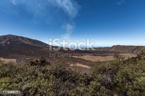 smoke from active volcano piton de la fournaise at la reunion island, mascarene islands, french overseas territory.