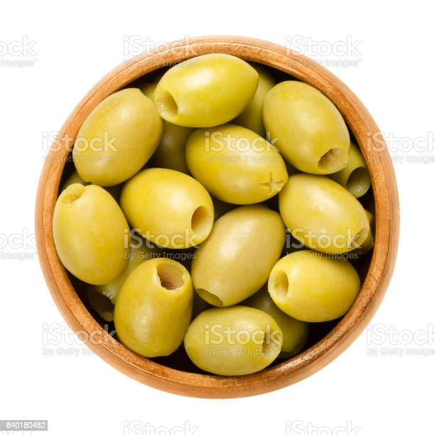 Pitted and marinated green olives in wooden bowl picture id840180482?b=1&k=6&m=840180482&s=612x612&h=2xivbvzaf94hmolzsmo2rttmgg7hxdvsoxdjy0wvy1y=