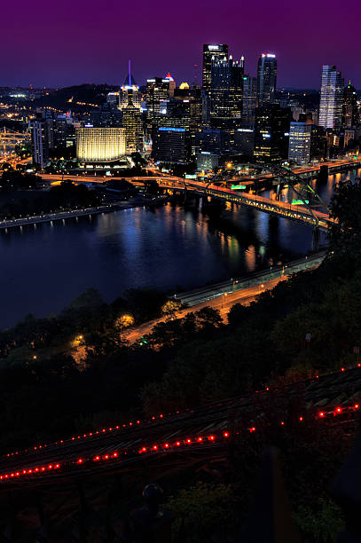 Pittsburgh at Night with Inclined Plane Pittsburgh, PA, USA - May 30, 2013: City of Pittsubrgh photographed at night featuring the Fort Pitt bridge and lights of the inclined plane. pittsburgh bridge stock pictures, royalty-free photos & images