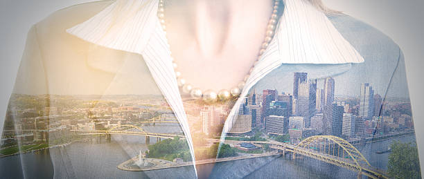Pittsburgh Business Woman Double Exposure A panoramic on the city on Pittsburgh, PA, USA double exposed with a business woman. pittsburgh bridge stock pictures, royalty-free photos & images