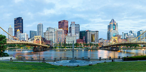 Pittsburgh, Pennsylvania Lit Up Pittsburgh, Pennsylvania lit up in the early evening. pittsburgh bridge stock pictures, royalty-free photos & images