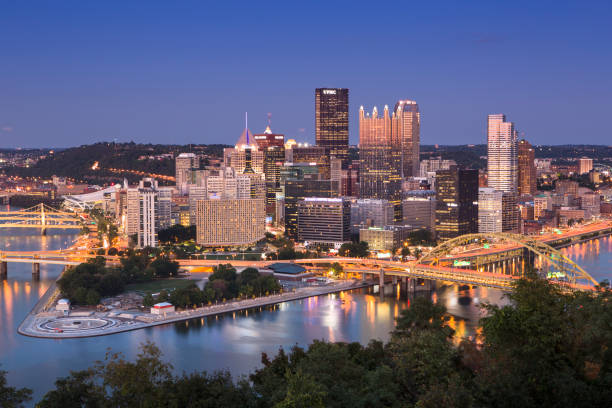 Pittsburgh Pennsylvania USA Skyline at night Pittsburgh, USA - September 19, 2012:  Pittsburgh is a city in the Commonwealth of Pennsylvania in the United States of America, and is the county seat of Allegheny County.  Located at the confluence of the Allegheny, Monongahela, and Ohio Rivers, Pittsburgh is known as both