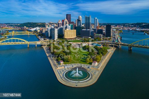 Downtown Pittsburgh skyline aerial view with Fort Duquesne (including a fountain), Point State Park, I-279, Allegheny River (left), Fort Duquesne Bridge (left), Monongahela River (right) and Fort Pitt Bridge (right) in the foreground.