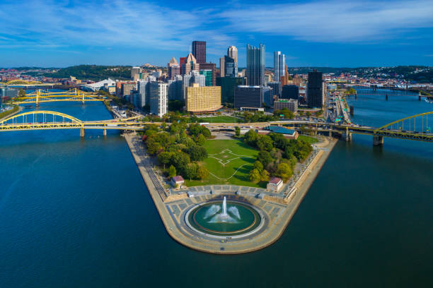 Pittsburgh Skyline Aerial With Fountain, Two Rivers And Bridges Downtown Pittsburgh skyline aerial view with Fort Duquesne (including a fountain), Point State Park, I-279, Allegheny River (left), Fort Duquesne Bridge (left), Monongahela River (right) and Fort Pitt Bridge (right) in the foreground. pittsburgh stock pictures, royalty-free photos & images