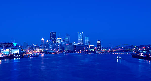 Pittsburgh Skyline at Night A view of Pittsburgh; Pennsylvania's cityscape at night overlooking Pittsburgh pittsburgh bridge stock pictures, royalty-free photos & images