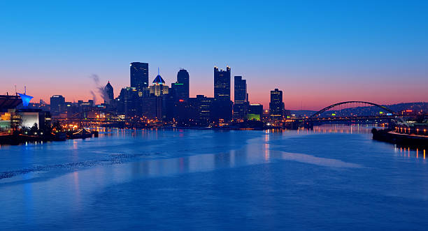 Pittsburgh Skyline at Sunrise A view of Pittsburgh; Pennsylvania's cityscape at sunrise overlooking Pittsburgh pittsburgh bridge stock pictures, royalty-free photos & images