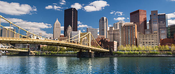 Pittsburgh Skyline panorama Roberto Clemente Bridge panoramic over Allegheny River Pittsburgh Pennsylvania USA pittsburgh stock pictures, royalty-free photos & images