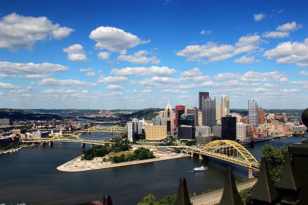 Pittsburgh Skyline Dramatic shot of a summer day over Pittsburgh, PA.  As seen from Mount Washington.  Corporate logos digitally removed for general usage. pittsburgh bridge stock pictures, royalty-free photos & images