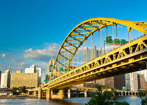 Pittsburgh's Fort Pitt Bridge Glowing in the Sunshine The Fort Pitt Bridge gateway into Pittsburgh. pittsburgh bridge stock pictures, royalty-free photos & images