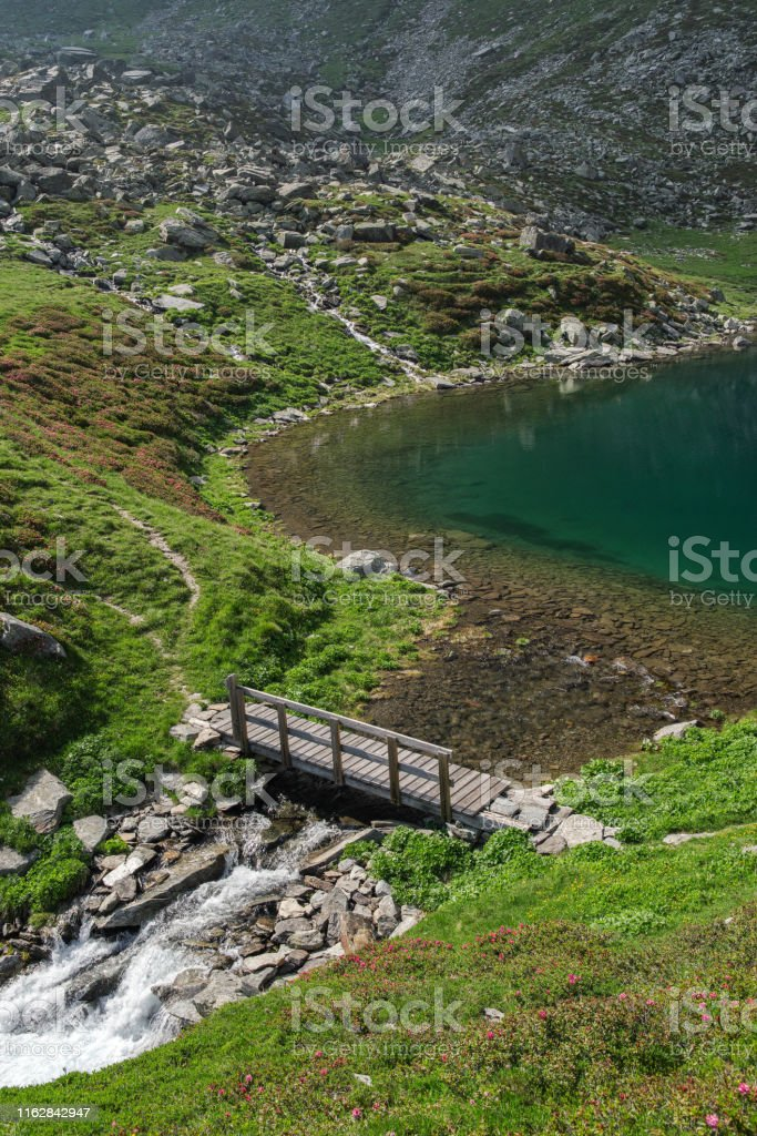 Piuro, Sondrio, Lombardy, Italy, June 29, 2019 - Small bridge across stream Acquafraggia, coming out from the lake of the same name (2043 m) - Стоковые фото Без людей роялти-фри