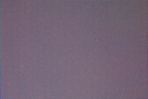 Zoom in to see grid of individual pixels photographed in high detail on an LCD computer screen.