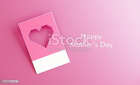 Pixelated cut out heart shape on pink background. Horizontal composition with copy space.
