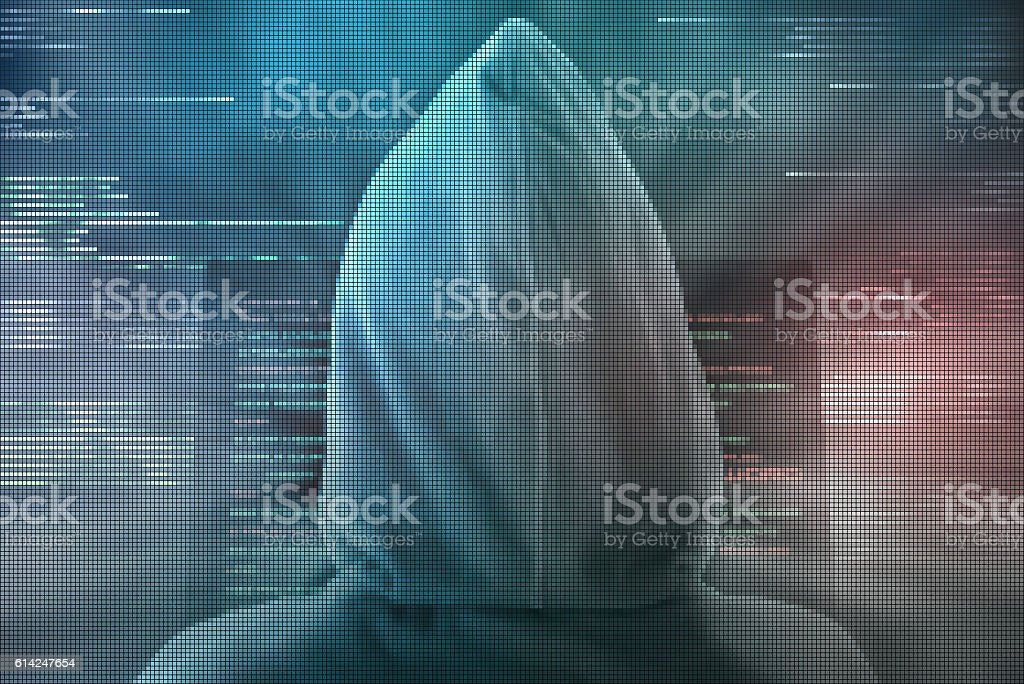 Pixelated hacker encoding personal data from computer monitor stock photo