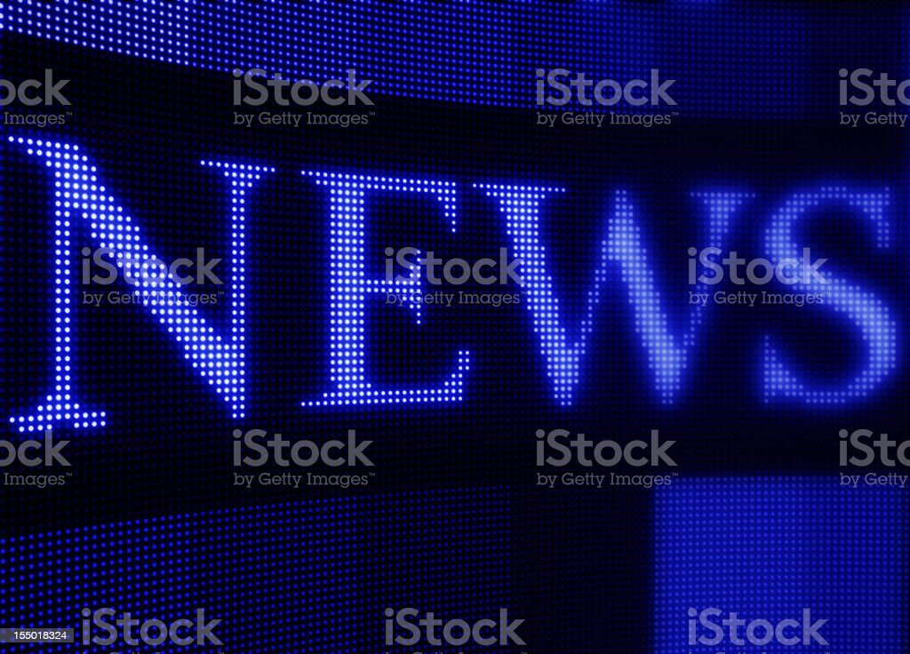 Pixelated text news on digital news screen royalty-free stock photo