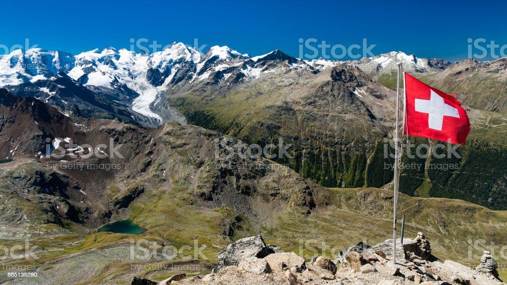 Piz Bernina and Morteratsch Glacier with Swiss flag, Engadin, Switzerland stock photo