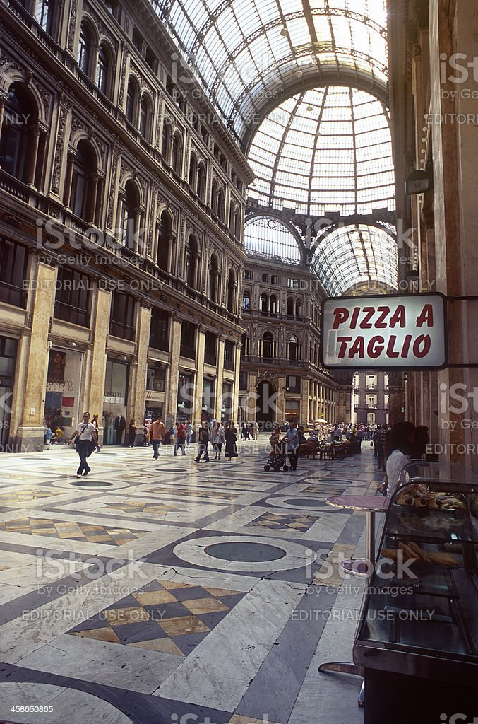 Pizza a taglio at The Umberto I Gallery in Naples royalty-free stock photo