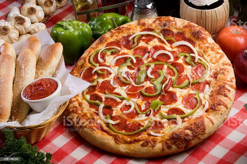 Pizza and Breadsticks stock photo