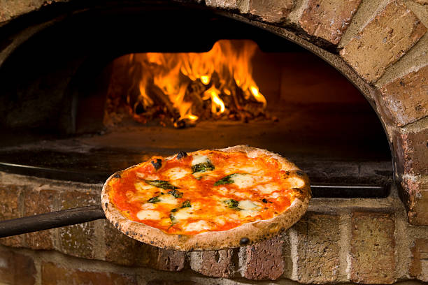Pizza and brick oven stock photo