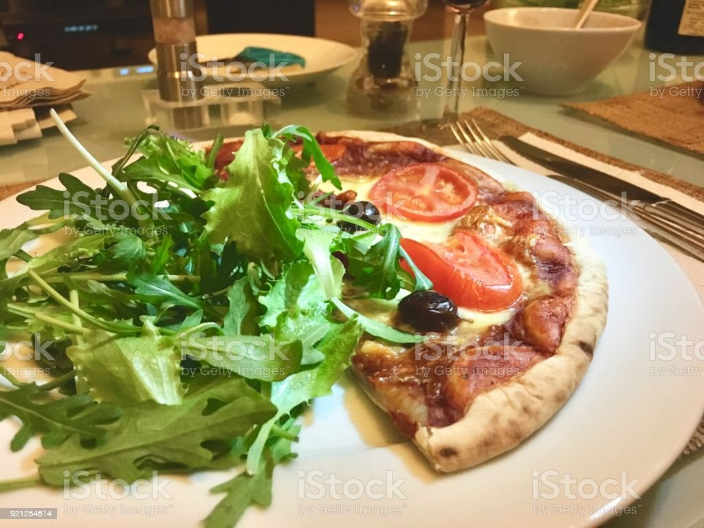Pizza and Green Salad on Plate stock photo