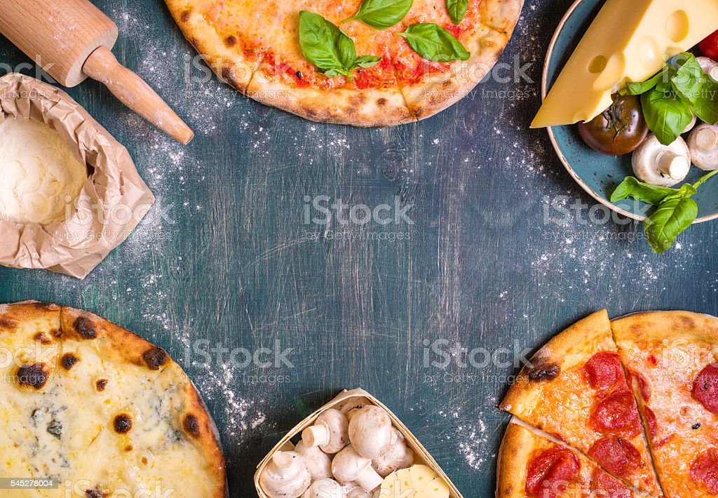 Pizza and ingredients background stock photo