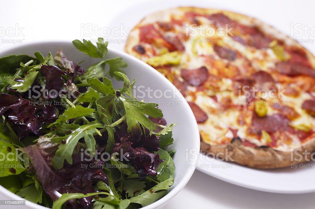 Pizza and salad (high key) stock photo
