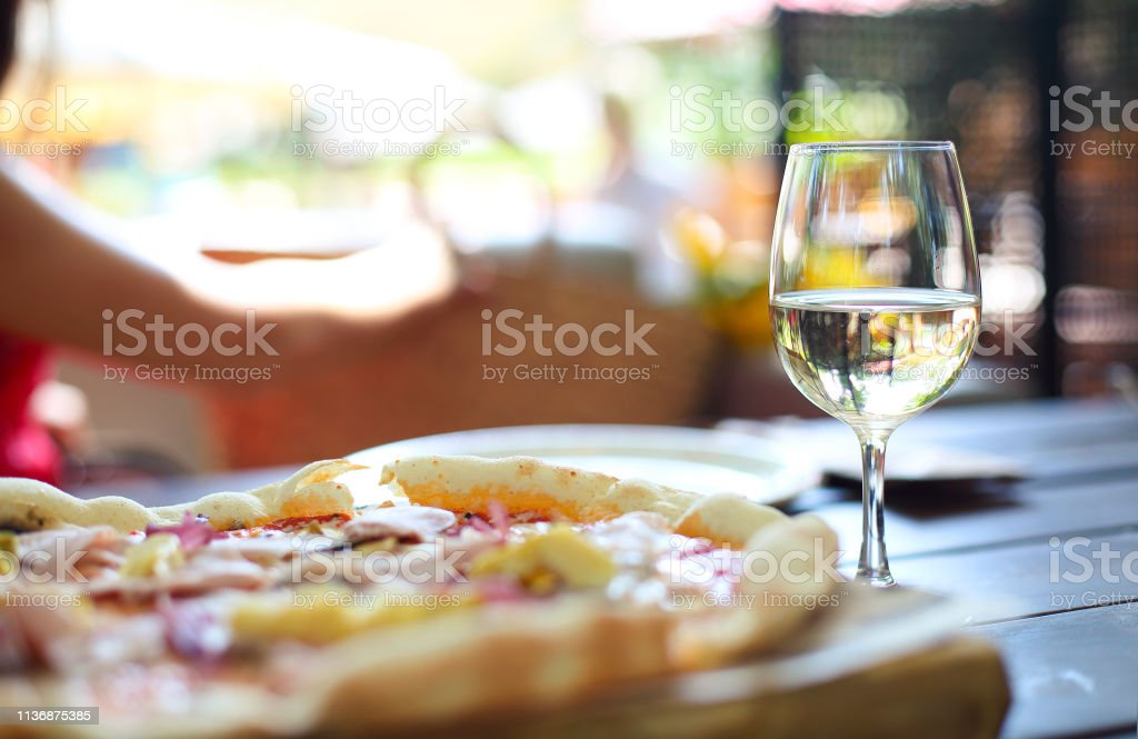 Pizza And White Wine In Outdoor Restaurant Stock Photo Download