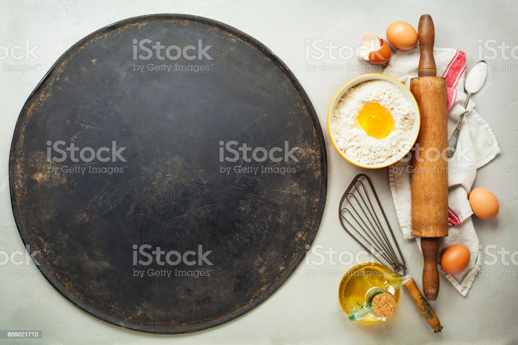Pizza  baking sheet and ingredients stock photo