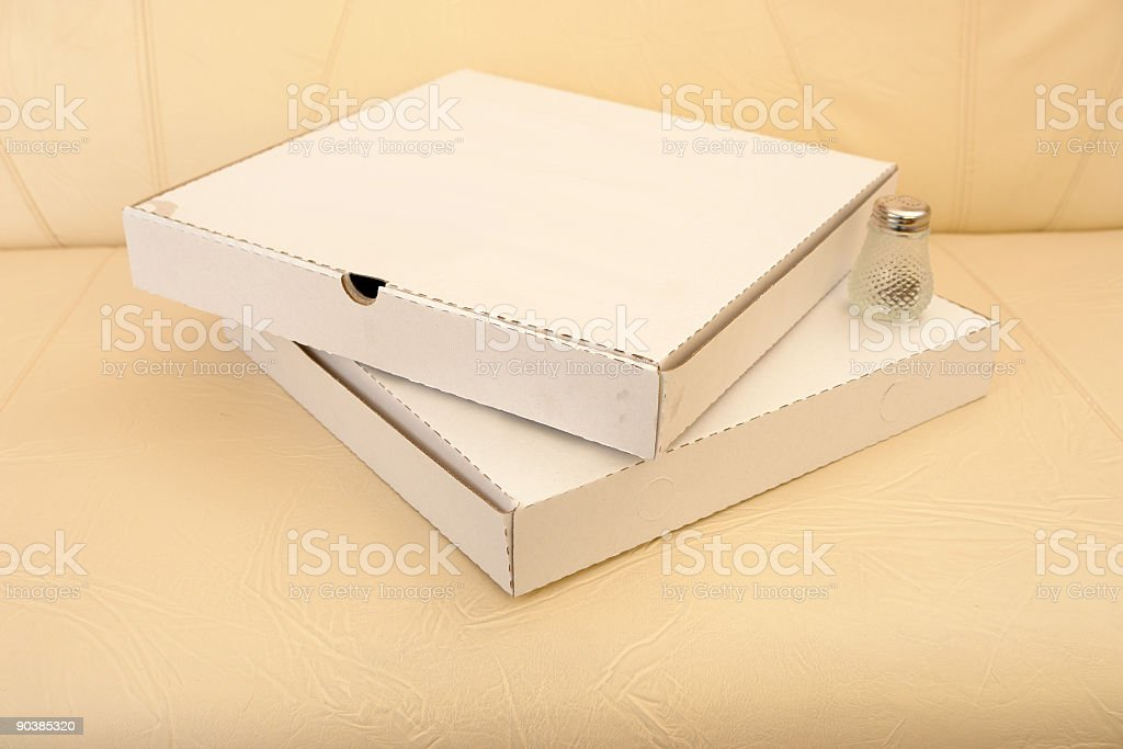 Pizza boxes on the sofa royalty-free stock photo