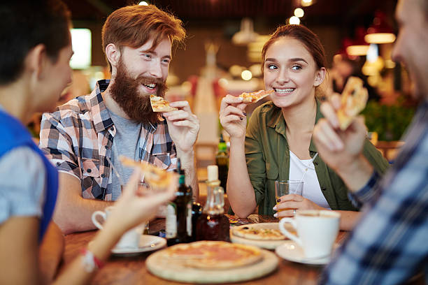 pizza break - pizzeria stock photos and pictures