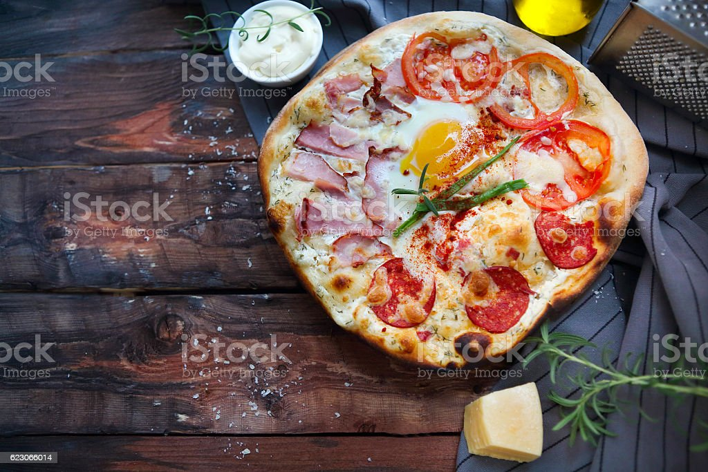 Pizza carbonara with bacon, salami, parmesan cheese and chicken stock photo