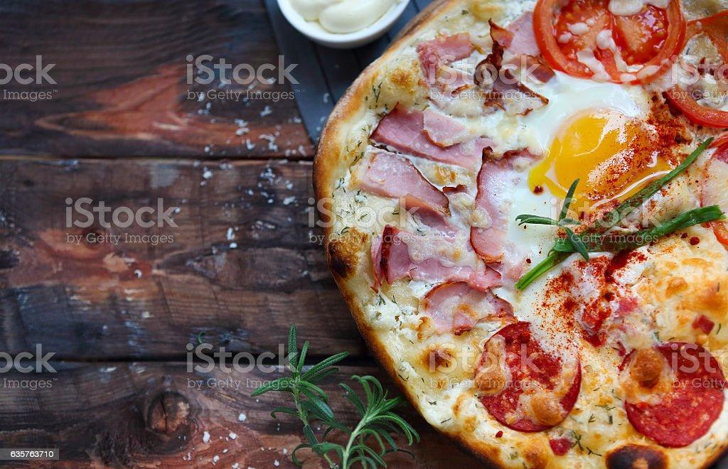 Pizza carbonara with bacon, salami, parmesan cheese stock photo