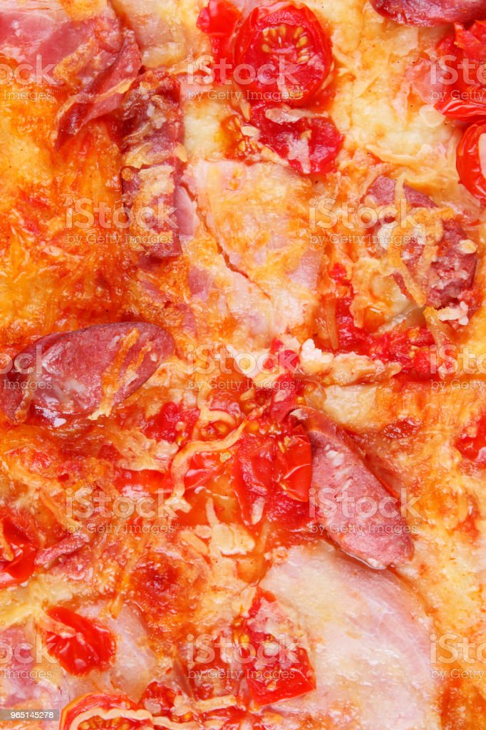 Pizza close-up, Italian pizza with bacon, tomatoes, sausages and cheese, appetizing pastry top view, baked cheese cake with meat, delicious lunch zbiór zdjęć royalty-free