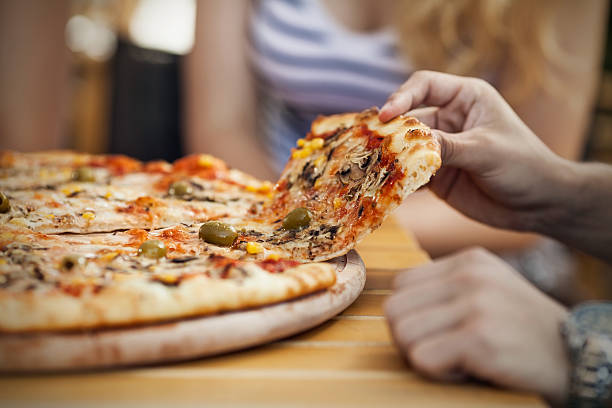 pizza close-up - pizzeria stock photos and pictures