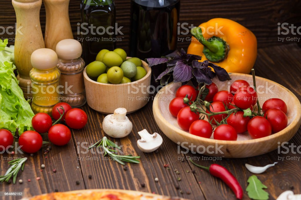Pizza cooking ingredients. Dough, vegetables, cheese and spices royalty-free stock photo