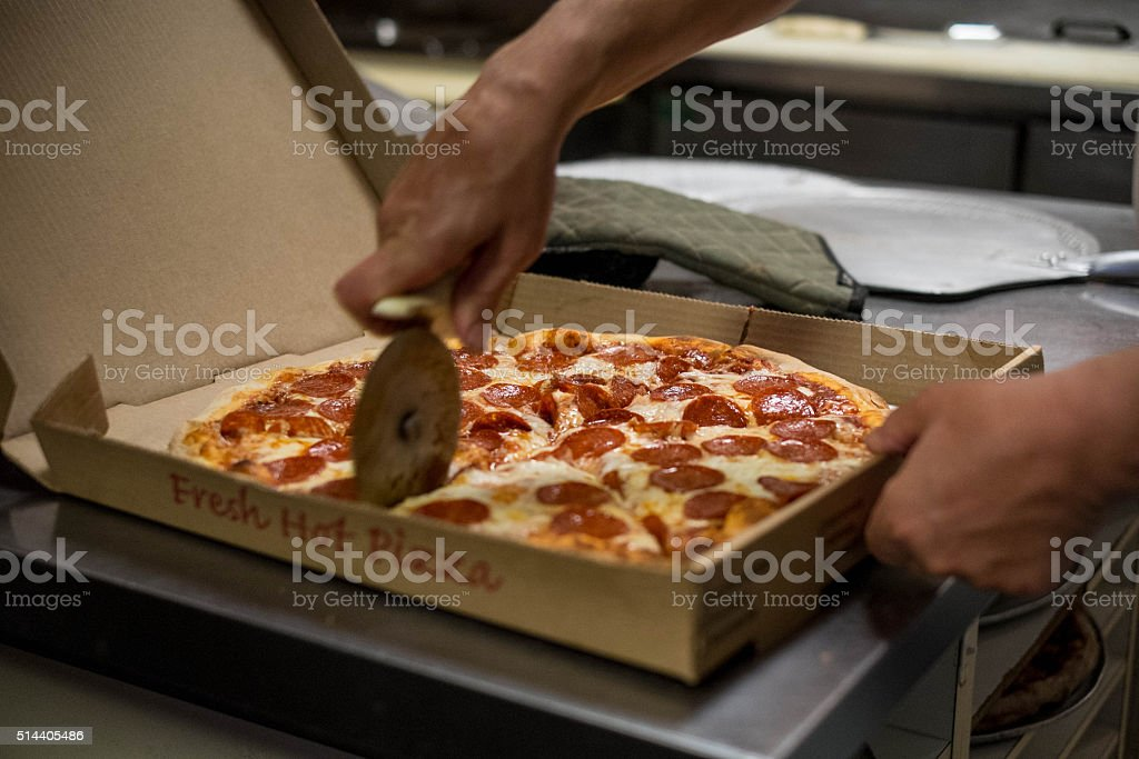 pizza cut stock photo