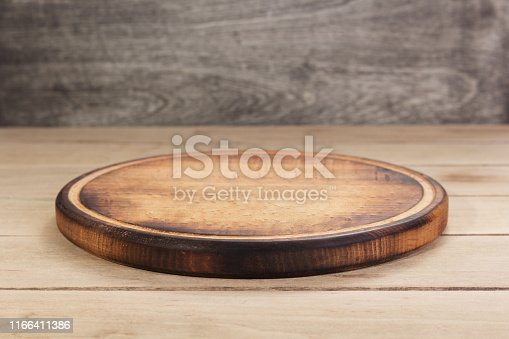 pizza cutting board at rustic wooden table plank background