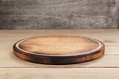 pizza cutting board at rustic wooden table plank