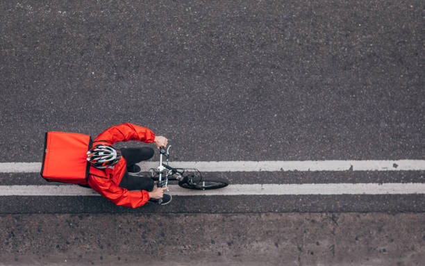 Pizza delivery guy on bicycle stock photo
