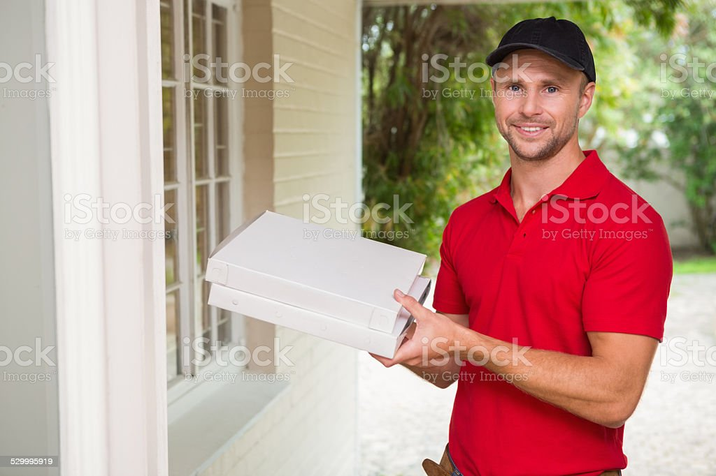 Pizza delivery man delivering pizzas stock photo