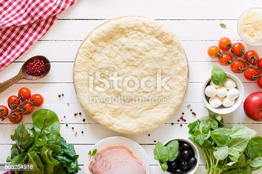 1136817041 istock photo Pizza dough and ingredients for making a pizza 805254916