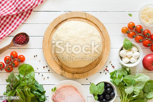 istock Pizza dough and ingredients for pizza 816139800