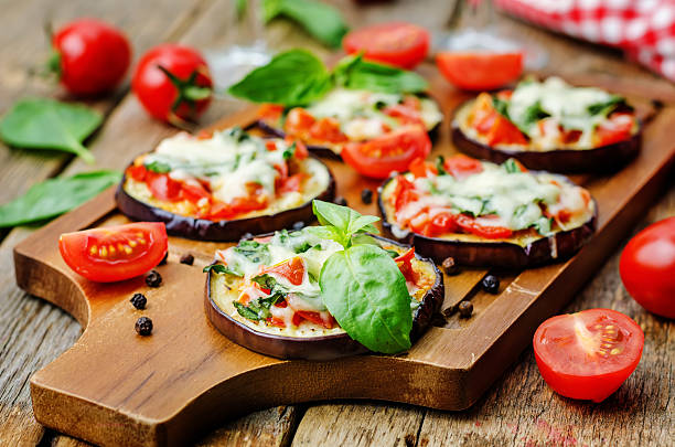 pizza eggplant with tomatoes and Basil stock photo
