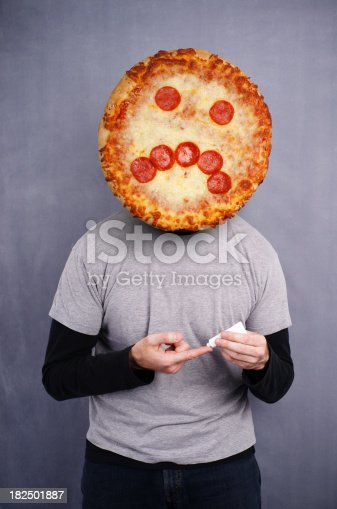 Guy with a pizza face about to put on acne medicine.