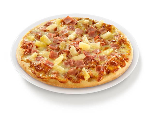 Pizza au jambon et à l'ananas sur une assiette - Photo