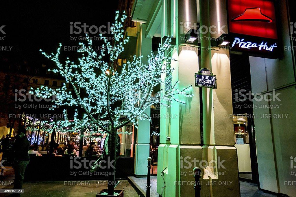 Pizza Hut and Christmas illumination on Paris Street stock photo