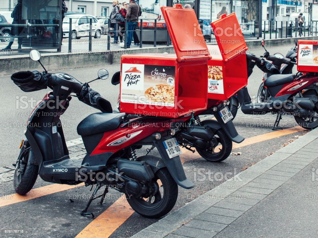 pizza hut delivery motorcycle parked on a street stock photo