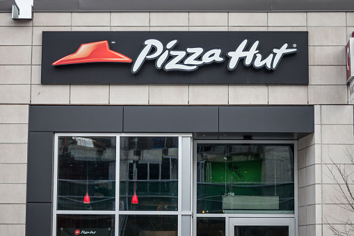 Pizza Hut logo in front of their local restaurant in Ottawa, Ontario. Pizza hut is an American chain of fast food selling pizzas and italian food