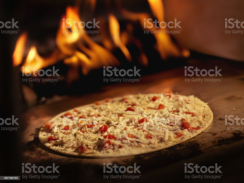 Pizza in a Wood Burning oven stock photo